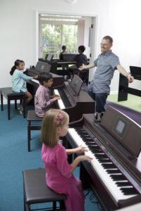 Greg and Students at the Piano Express